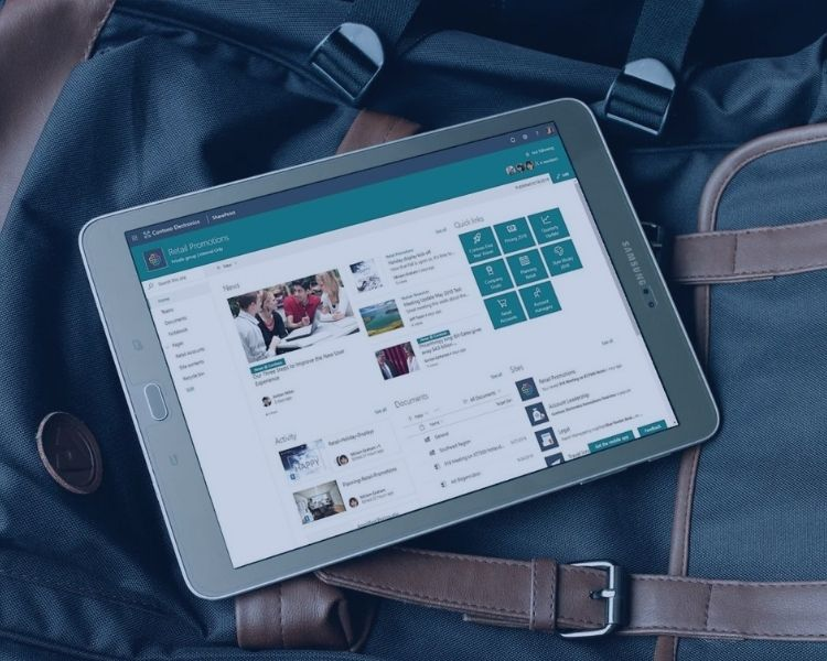 Tablet on a rucksack displaying sharepoint